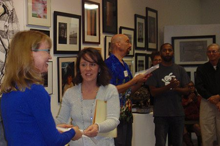 Leigh receiving award in Juried Show in Mint Hill, NC.