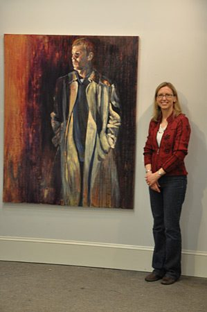 Leigh displays paintings at an Art Exhibit at Winthrop University.
